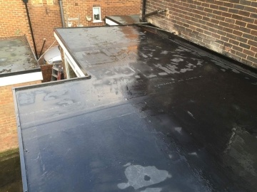 flat roof being washed