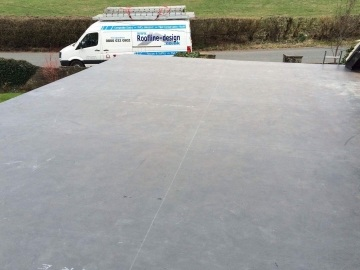 flat roof with roofline van in distance