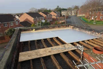 installing insulation on a flat roof