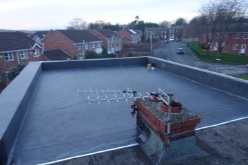 adding rubber to a flat roof